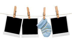 Blank polaroid baby sock. Blank polaroid frames with baby sock Stock Images