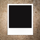 Blank polaroid photo frame. On brown color notice board background Royalty Free Stock Images