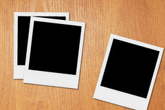 blank polaroid photo frames on the desk stock photography