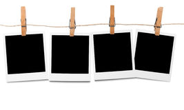 Blank polaroid photos on line. Blank photo frames hanging on line stock photo
