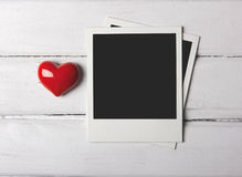 Blank polaroid photos with red heart Stock Photo