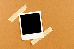 Blank polaroid style instant photo print with sticky tape Stock Photography