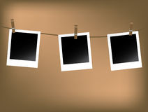 Blank polaroids. Three blank polaroids on washing line Stock Photography