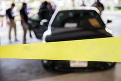 Blank police line protect vehicle in crime scene investigation t stock photos