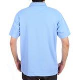 Blank polo shirt (back side) on man. Blank blue polo shirt (back side) on man isolated on white background Stock Photo