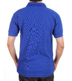 Blank polo shirt (back side) on man. Blank blue polo shirt (back side) on man isolated on white background Royalty Free Stock Image