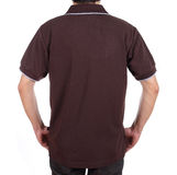 Blank polo shirt (back side) on man. Blank brown polo shirt (back side) on man isolated on white background Royalty Free Stock Photo
