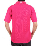 Blank polo shirt (back side) on man. Blank pink polo shirt (back side) on man isolated on white background Royalty Free Stock Images