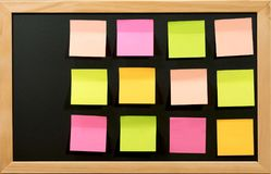 Blank Post it on black board for memo or business. Concept education or business Royalty Free Stock Photos