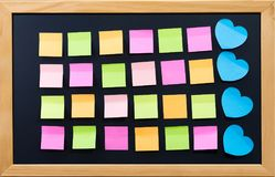 Blank post it on black board for memo or business. Concept education memo or business plan Royalty Free Stock Photography