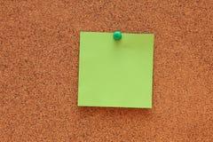 Blank Post-it Note. On corkboard (bulletin board Stock Image