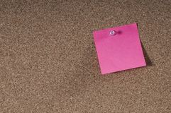 Blank post notes. Blank post-it notes affixed to the corkboard Stock Photography