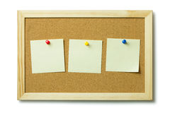 Blank post it notes on a cork notice board Stock Photo