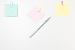 Blank Post-it Notes, pencil, and paper clips Stock Photos