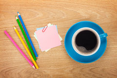 Blank post-it with office supplies and coffee cup Royalty Free Stock Image