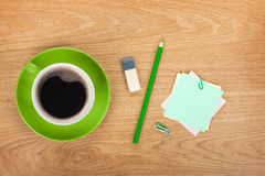 Blank post-it with office supplies and coffee cup Stock Images