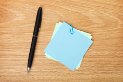 Blank post-it with pen Stock Photo