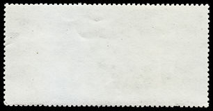 Blank post stamp on black background Royalty Free Stock Photo