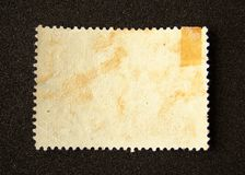 Blank postage stamp. On black background stock photography