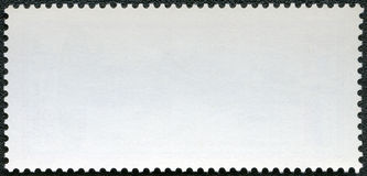 Blank postage stamp on a black background Stock Image
