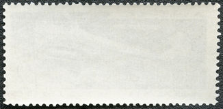 Blank postage stamp on a black background Stock Photo