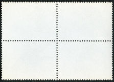 Blank postage stamp block souvenir sheet on a black background Royalty Free Stock Photos