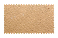 Blank postage stamp with cardboard Royalty Free Stock Images