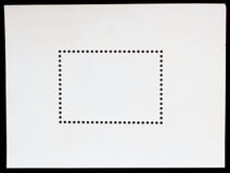 Blank postage stamp framed by black border texture Royalty Free Stock Photo