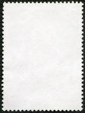 Blank postage stamp sheet on a black background stock photography