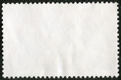 Blank postage stamp sheet on a black background Royalty Free Stock Photography