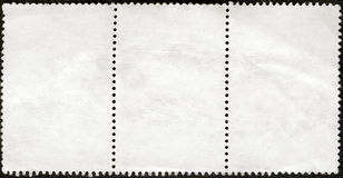 Blank postage stamps block of three framed Stock Photos