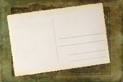 Blank postcard on an antique spine Stock Images