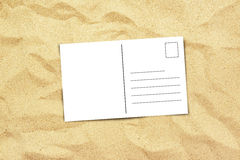 Blank postcard on beach sand, top view Royalty Free Stock Image