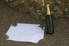 Blank postcard and champagne bottle Royalty Free Stock Images