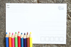 Blank postcard and crayons royalty free stock photo