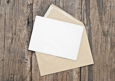 Blank postcard and envelope. On old wooden background Stock Photo