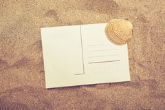 Blank postcard and sea shell in hot beach sand Stock Photo