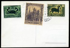 Blank postcard with stamps. And postage meter from San Marino republic Stock Photos