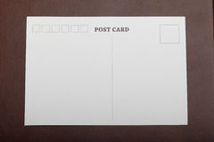 Blank postcard on suitcase Stock Images