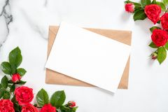 Free Blank Postcard With Rose Flowers Frame And Craft Paper Envelope On Marble Background. Greeting Card Mockup For Valentine`s Day, Royalty Free Stock Image - 157687286