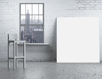 Blank poster. Brick loft with chair and blank poster royalty free stock photo