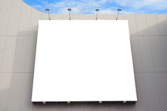 Blank poster board wall with copy space for your text message in modern shopping mall on a cloudy day. Blank poster board wall in modern shopping mall on a stock photos