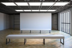 Blank poster in exhibition gallery. Loft style empty exhibition white blank banner in gallery with white benches on parquet floor and floor-to-ceiling window.3D Stock Photo