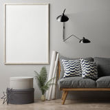 Blank poster on grey wall, hipster sofa Royalty Free Stock Photo