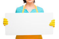 Blank poster in hands housewife isolated Stock Image