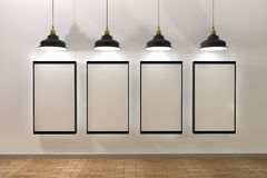 Blank poster illuminated by lamps above Stock Images