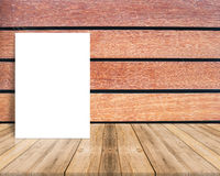 Blank poster leaning at plank wood wall and diagonal wooden floo Stock Photography
