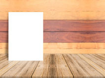 Blank poster leaning at plank wood wall and diagonal wooden floo Royalty Free Stock Images