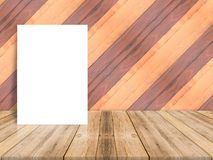 Blank poster leaning at plank wood wall and diagonal wooden floo Stock Image