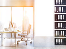 Blank poster in office toning. Blank poster in office interior with workplace, shelves with documents and New York city view. Toned image. Mock up, 3D Rendering Stock Image